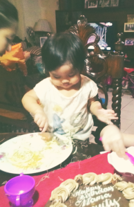 Sophia eating pancit at her granny's birthday party.